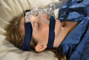 Woman Wearing CPAP Breathing Machine Mask