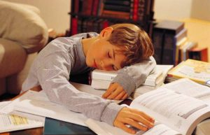 child sleeping at desk 600